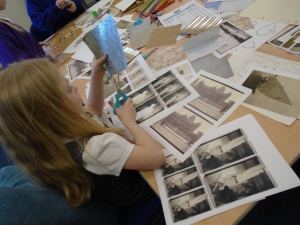 Photograph of a child creating an artwork at one of the sessions run by Comics Youth